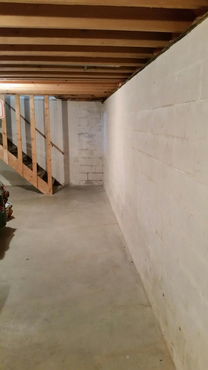 Before foreman Justin Reger waterproofed the Peoria basement, the basement was stained from water damage, and the walls were starting to bow.