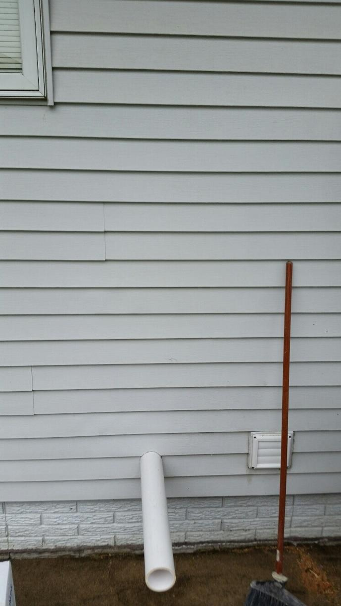 The radon mitigation system runs both inside and outside the home. The system is fixed to the wall outside the home.
