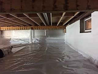 The fully encapsulated crawlspace is bright white, and dry!