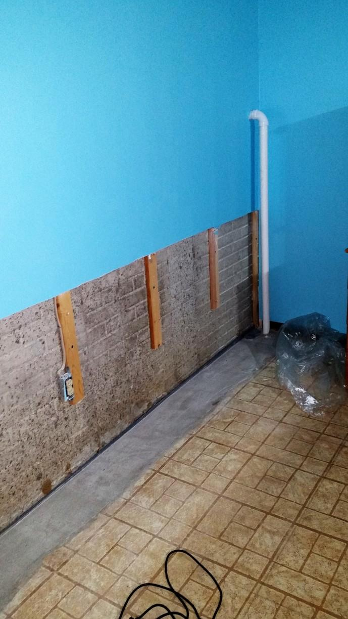 Water damaged dry wall is removed prior to the installation of EverLast Walls.