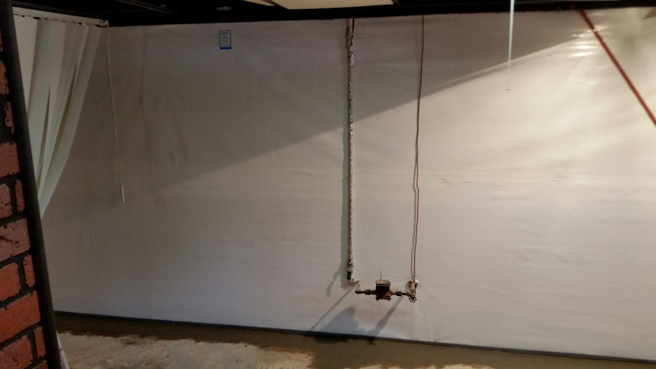 Obstacles like the pipes pictured here are no problem for MidAmerica Basement System's experienced installation crews.