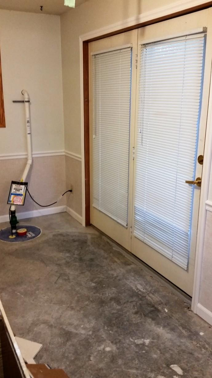 The SuperSump sump pump tucks nicely behind the door, and looks pretty good with the EverLast Wall Restoration.