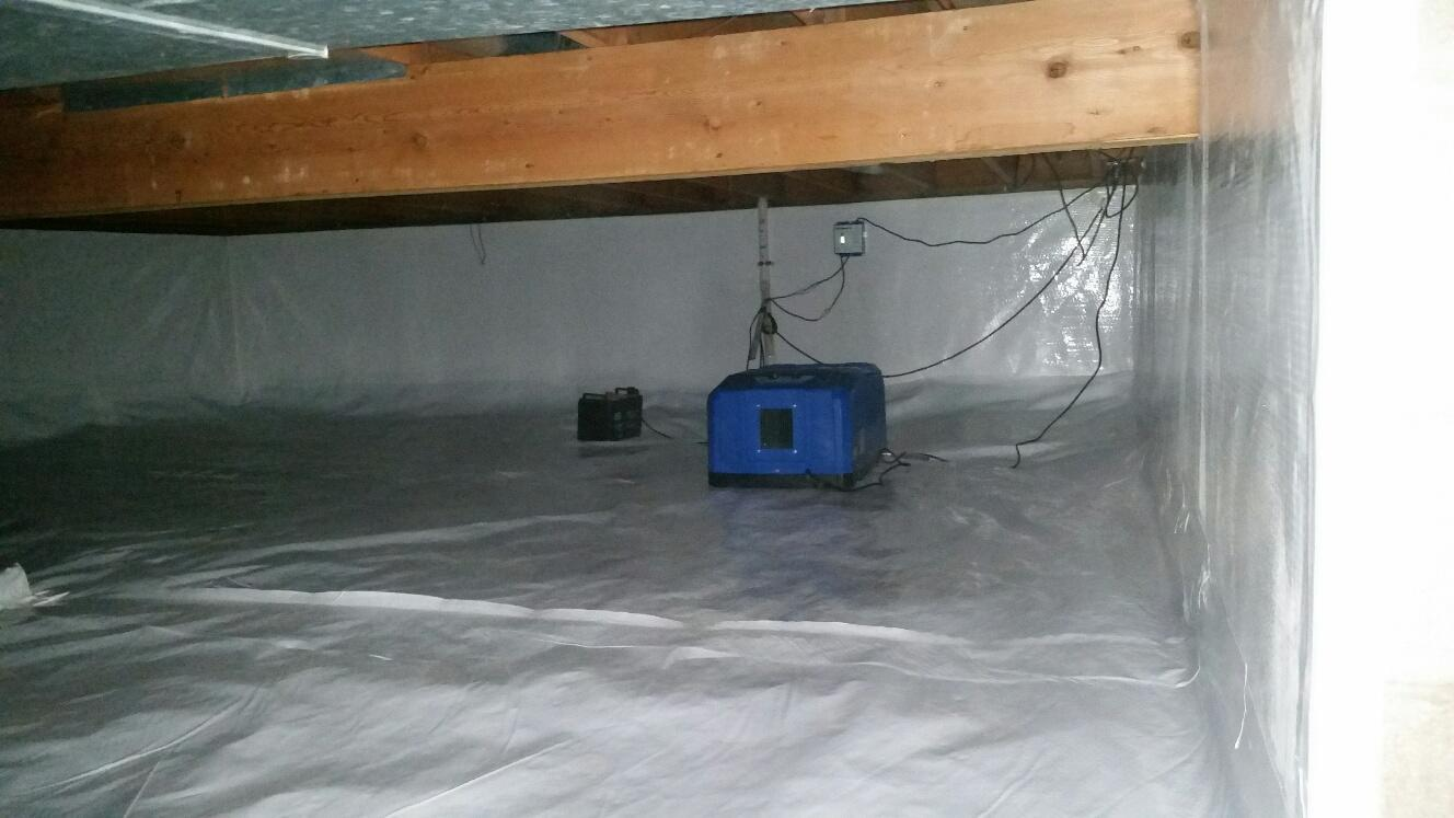 The small SaniDry dehumidifier controls the humidity levels in the crawlspace, effectively minimizing moisture in the home.