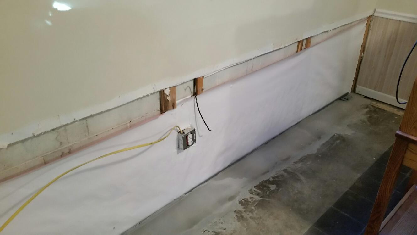 A CleanSpace strip is installed before the EverLast Wall Restoration Product is put in place.