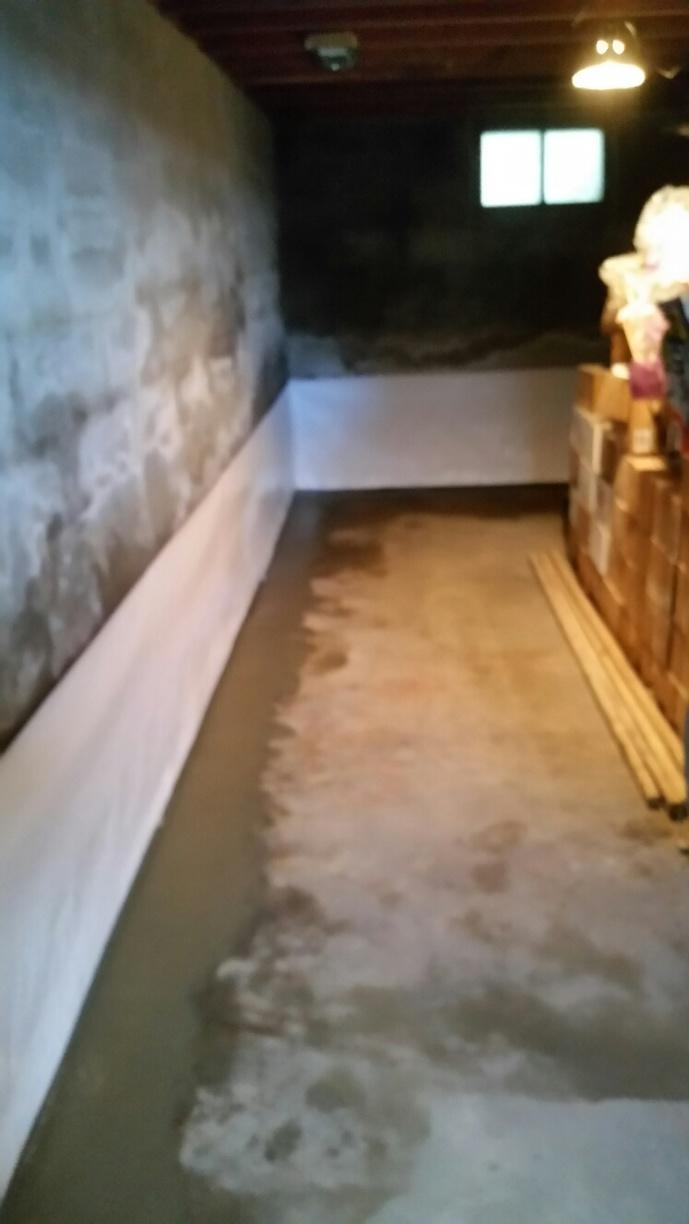 The completed installation shows WaterGuard and CleanSpace protecting the basement interior.