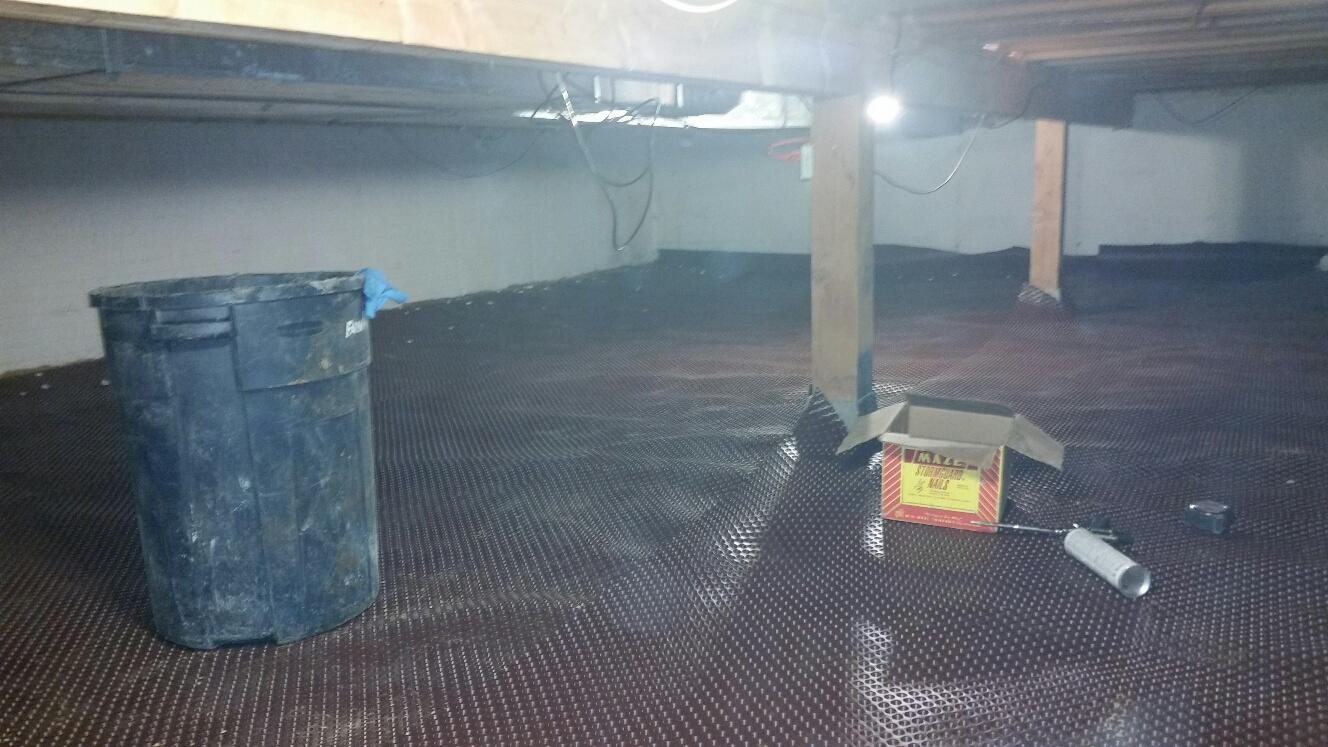 The CleanSpace Drainage Matting is laid to direct potential water toward the sump pump.