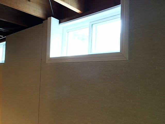 The EverLast Wall Panels are installed over the Basement to Beautiful Panels, and wrap around the EverLast Window.