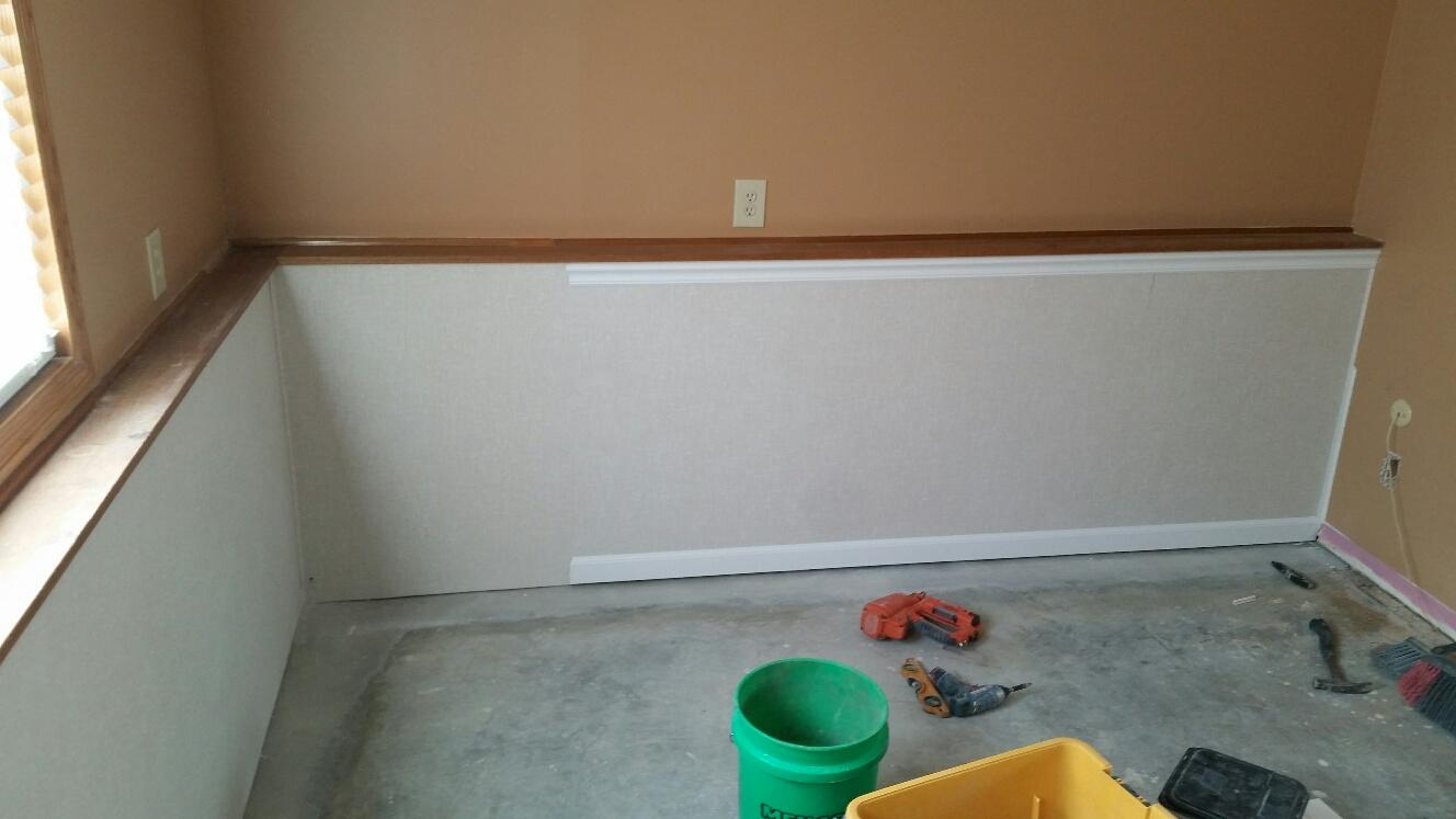 The EverLast Wall Panels are installed, but they are being lined with the baseboard and chair rail.