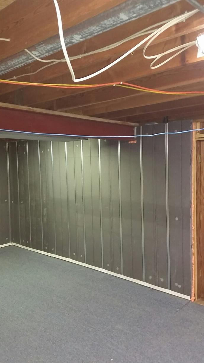 The Basement to Beautiful panels are graphite infused and reflect heat back into the basement. They come equipped with metal studs.