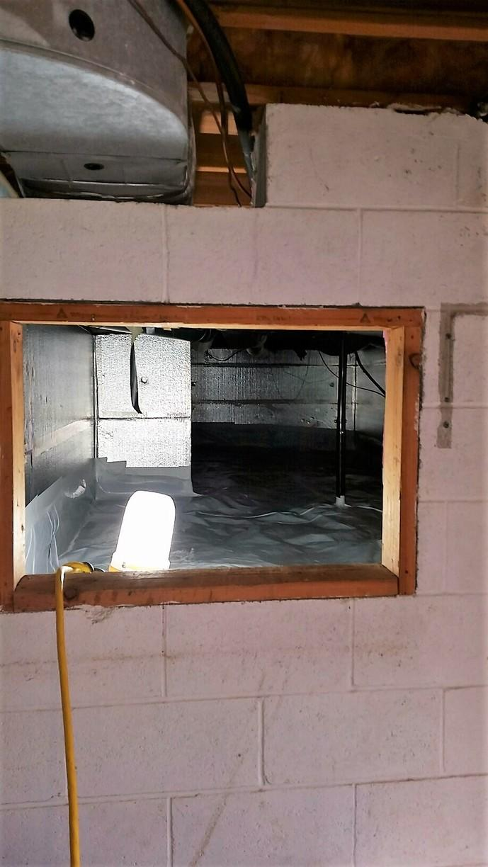 CleanSpace and SilverGlo brighten the crawlspace, making it a waterproofed, usable storage space.