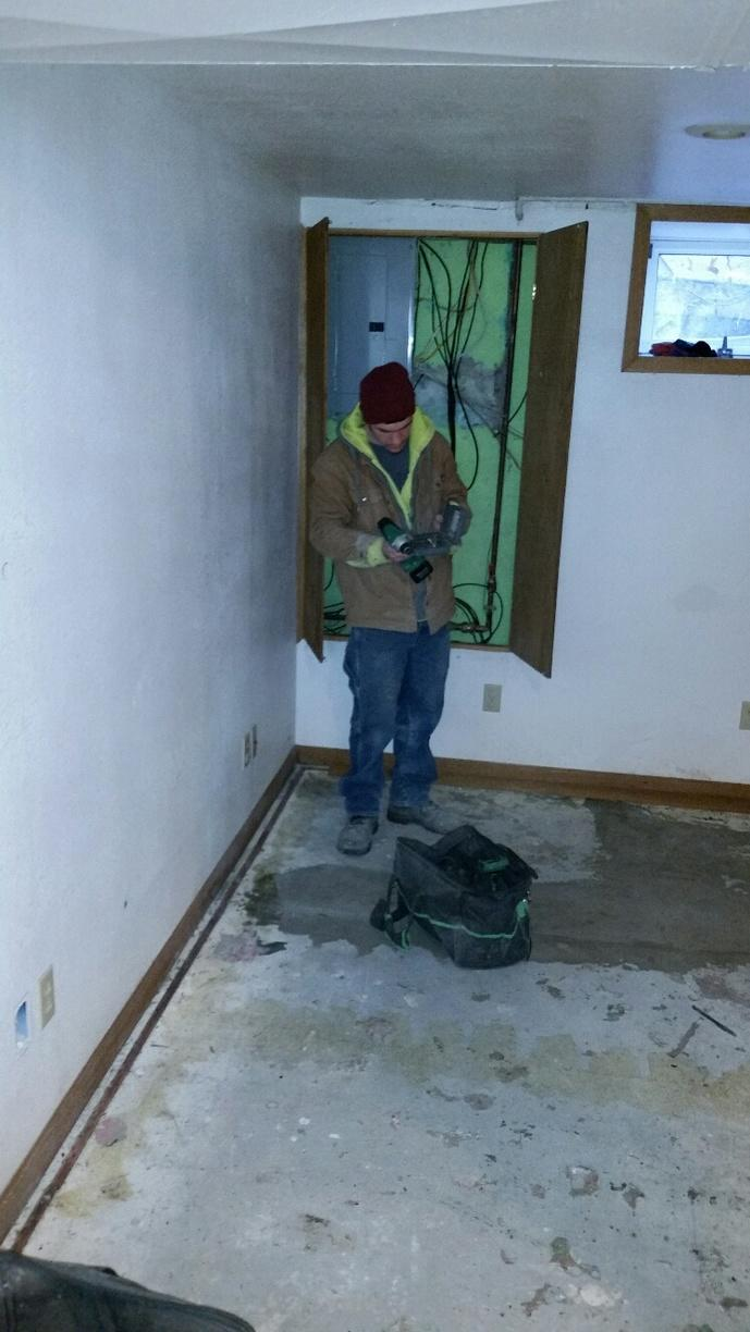 The floors and walls are damp in this Dubuque, IA basement.