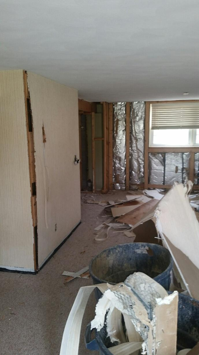 Drywall and carpet are removed.