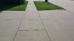 Front of house sidewalks are uneven