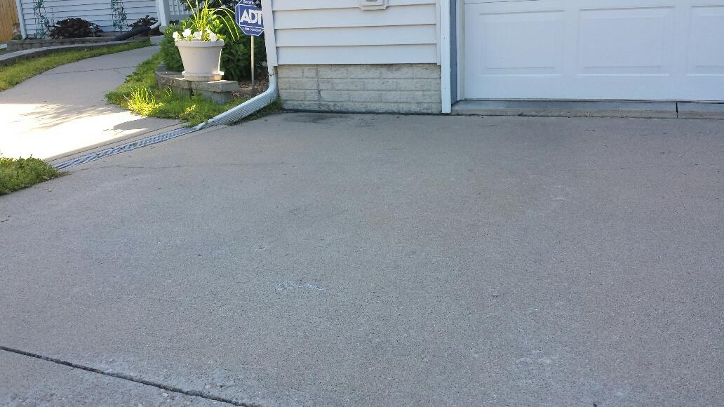 Sunken driveway has caused a 2 inch gap from garage foundation.