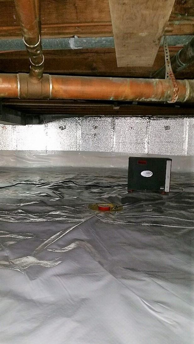 SmartDrain and SaniDry Sedona systems work together to keep the crawlspace free of moisture.