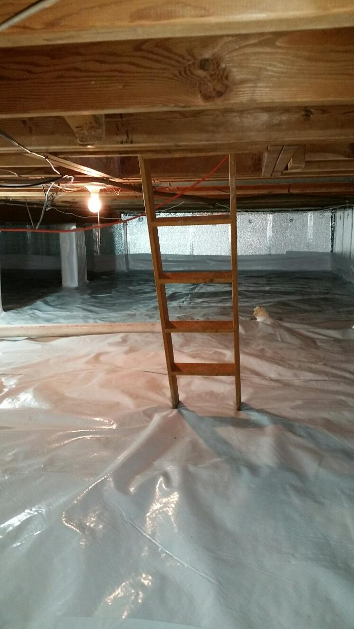 Total crawlspace encapsulation provides dry and energy efficient area.
