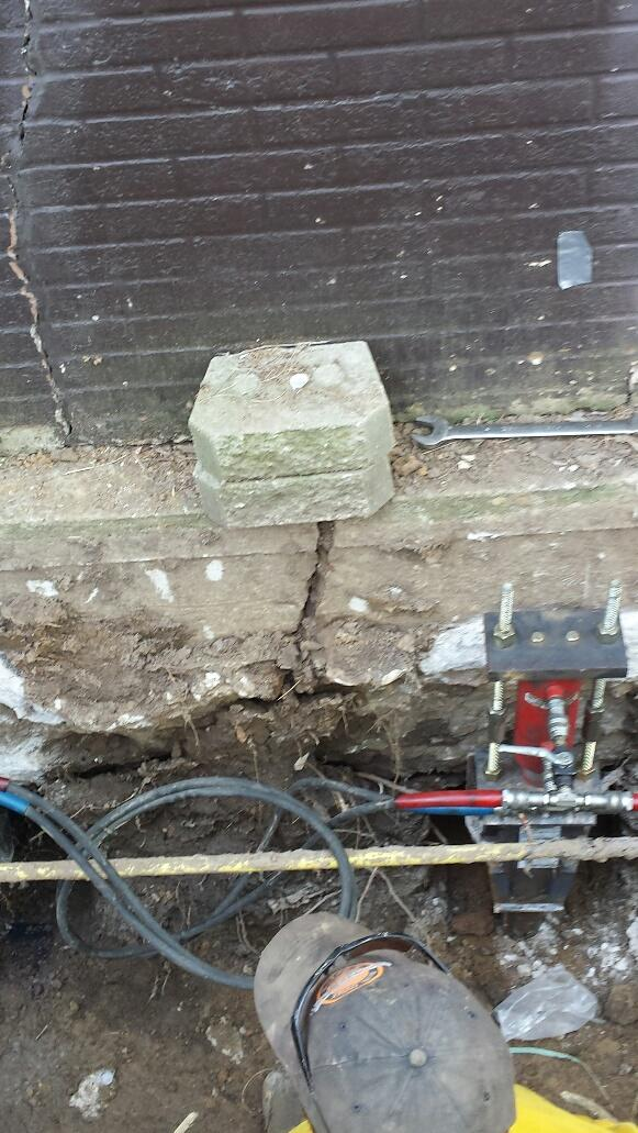 With the Push Piers in place, the home can be lifted and close foundation cracks.
