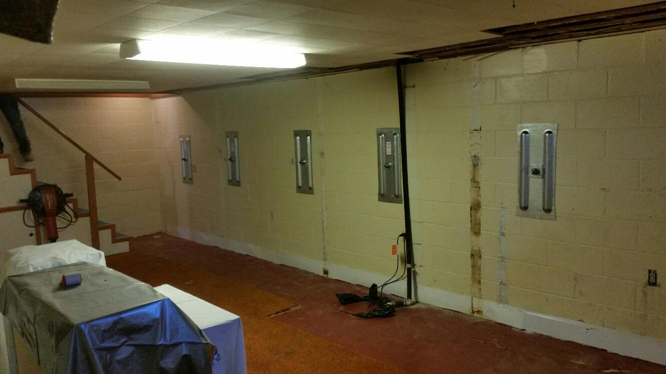 Moisture was still an issue after wall anchor and sump pump systems were installed.