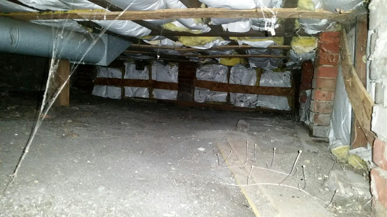 Untreated crawlspace has caused moisture to eat away at the floor joist system.