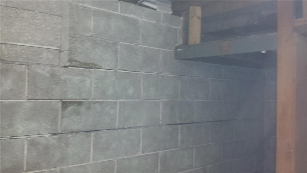 Some concrete blocks are sliding apart from the rest of the wall.