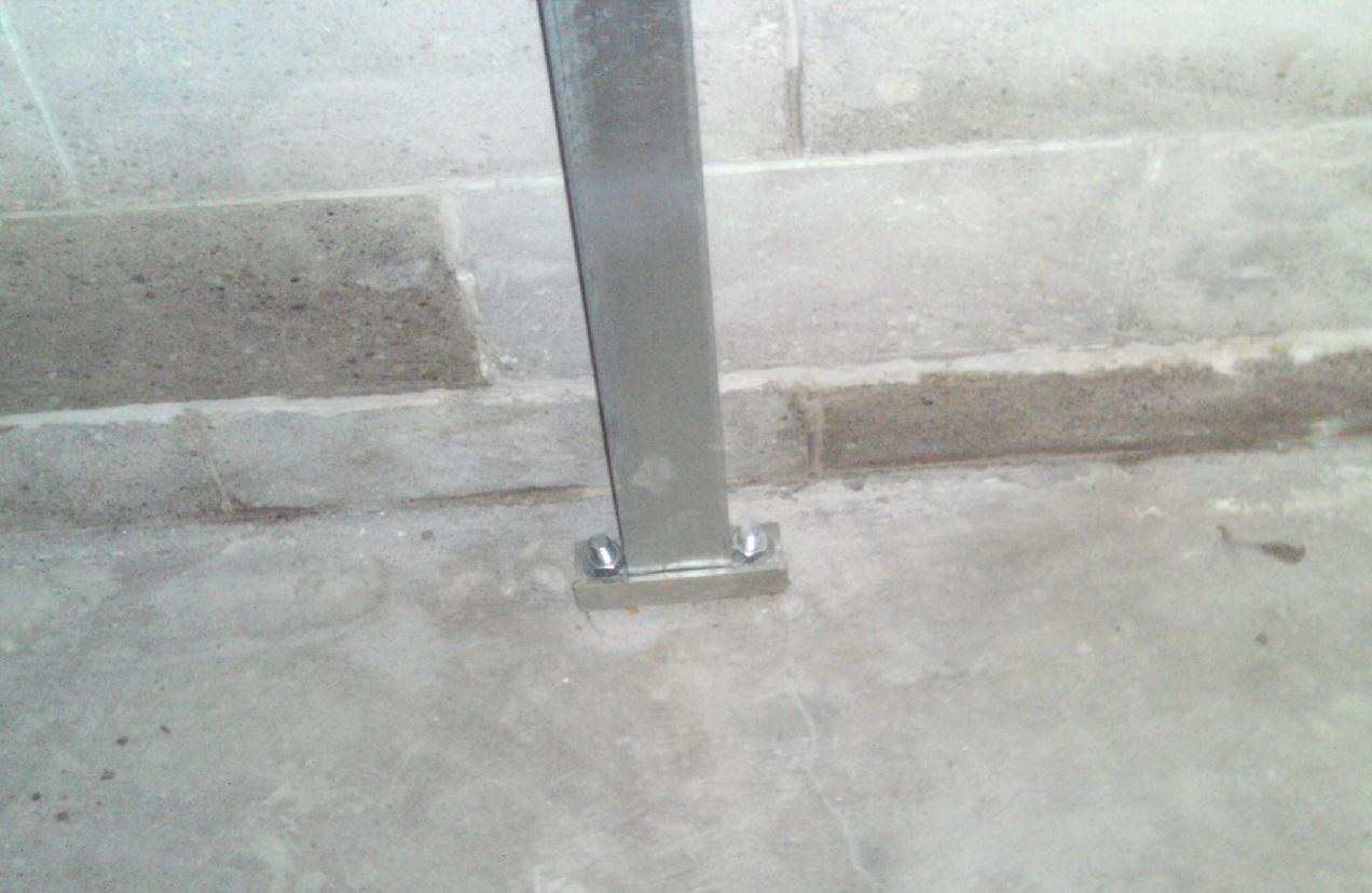 PowerBraces are placed tightly against the base of the wall.