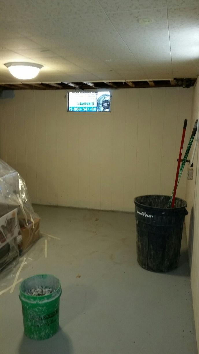 Basement is prepared for waterproof system installation.