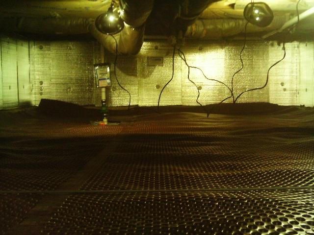 Drainage matting and a SmartSump are placed in the crawlspace to address the water issue.