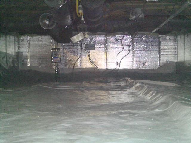 CleanSpace Liner is installed, providing a total crawlspace encapsulation, sealing off moisture from the area.