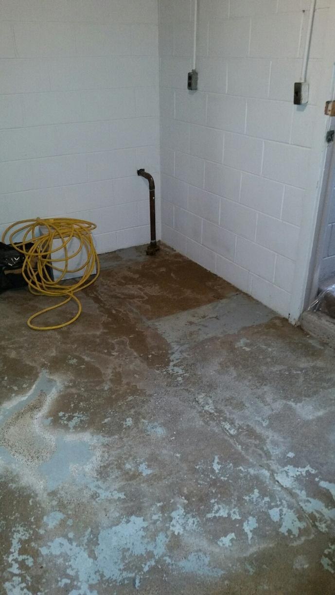 Leaking foundation has caused damage to the painted concrete.