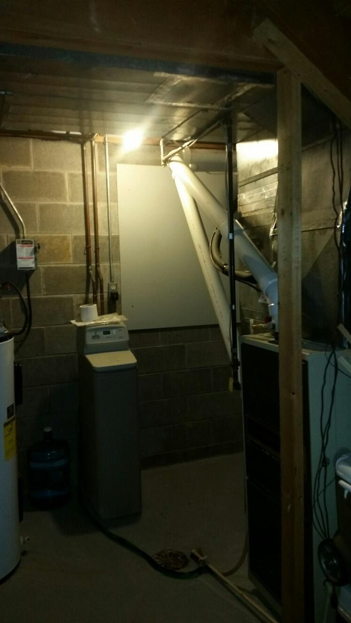 A crawlspace door was installed to provide the ultimate seal from the basement.