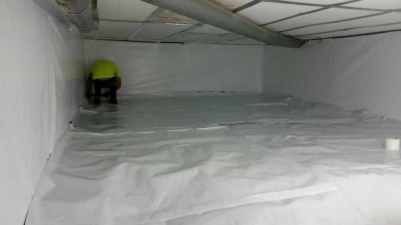 CleanSpace Liner is installed along the walls and floors, and crewmen prepare to seal the space.