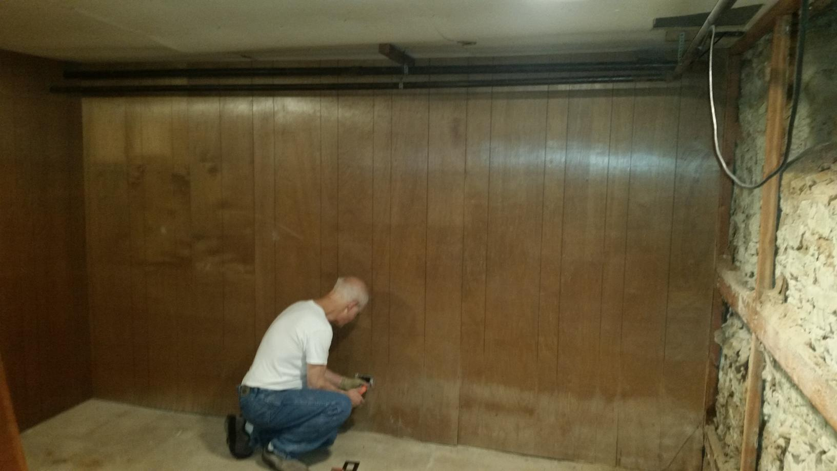 Warping and mold growth are highly noticeable to the wood paneling from moisture.