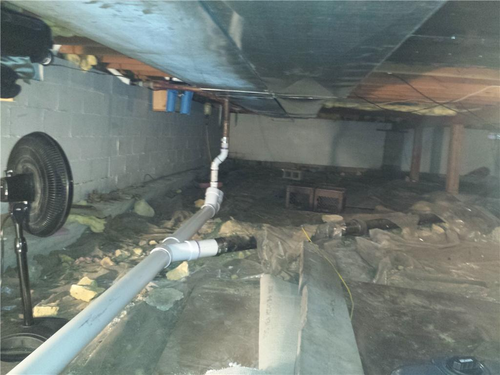 The exposed crawlspace kept leaking water into the basement, creating large messes and concerns for the homeowners.