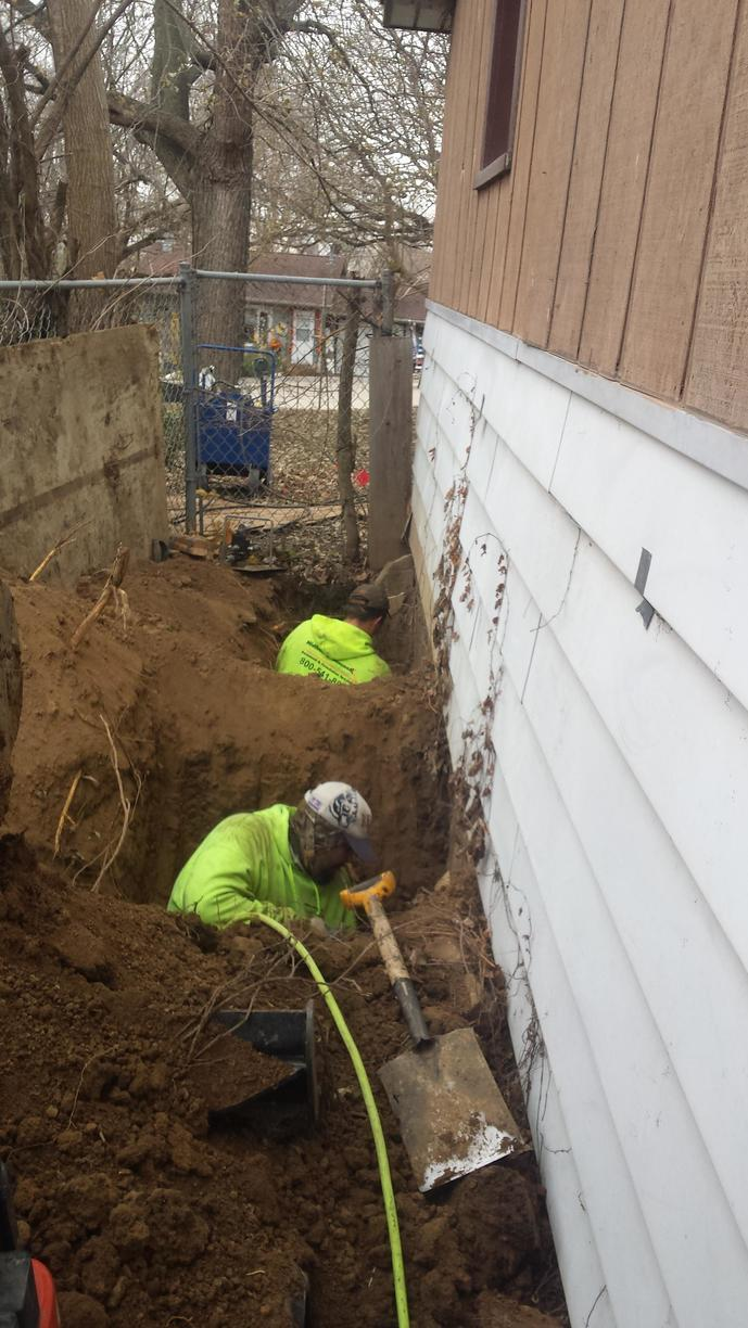 Each member of the team insures the proper depths are met to install the piers.