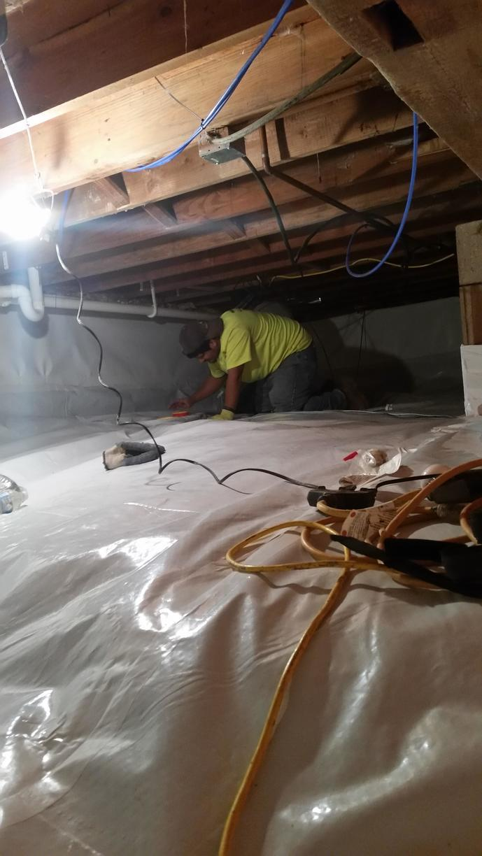 Workers install and check the installation of the SmartDrain.