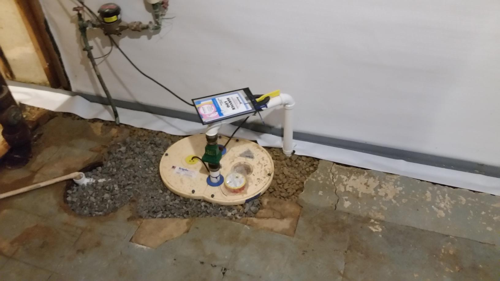 Sump Pump Install with WaterGuard Install to help prevent water seepage into the basement.