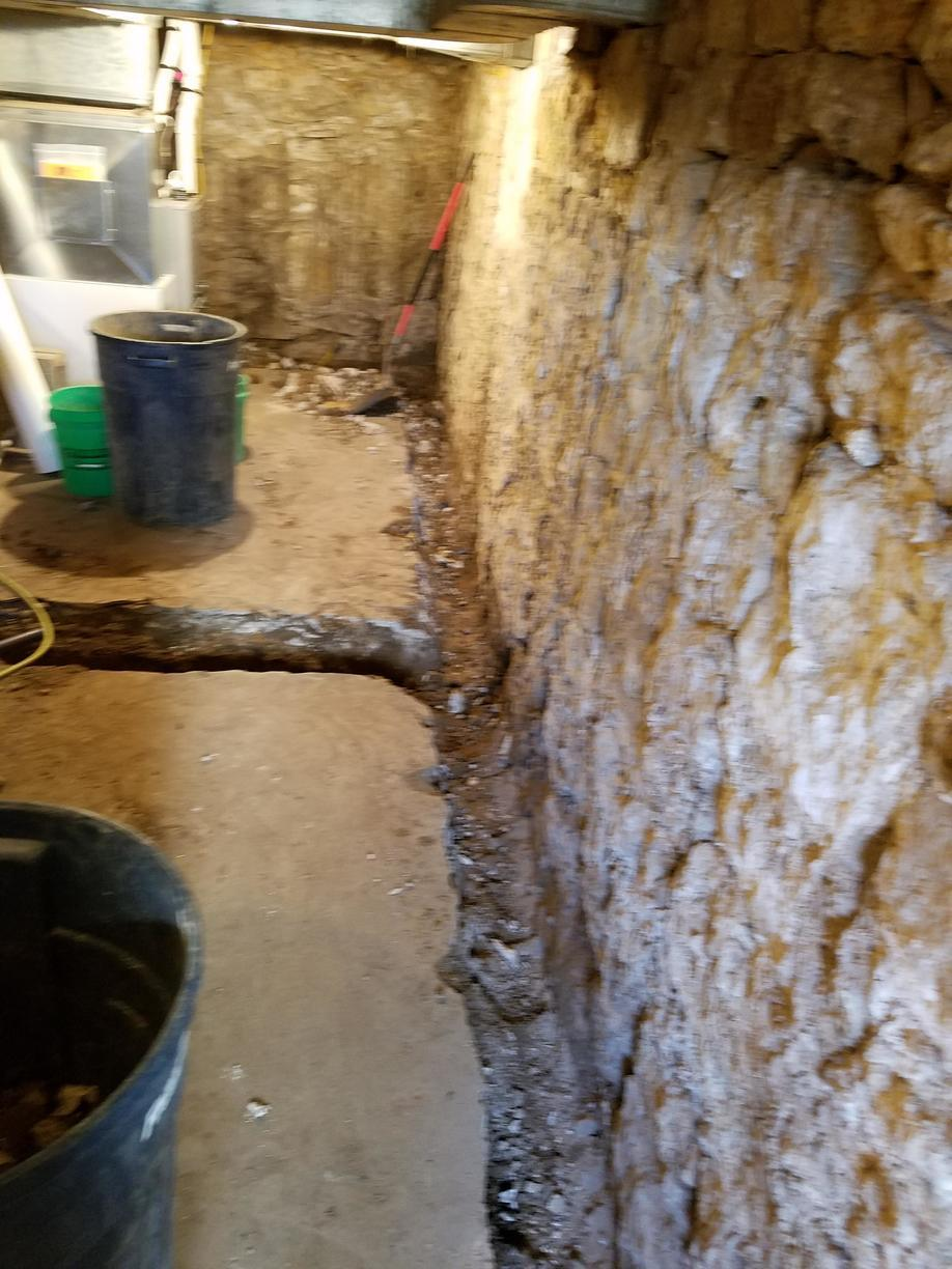 Before WaterGuard gets installed, a perimeter needs to be hammered out from the basement floor.