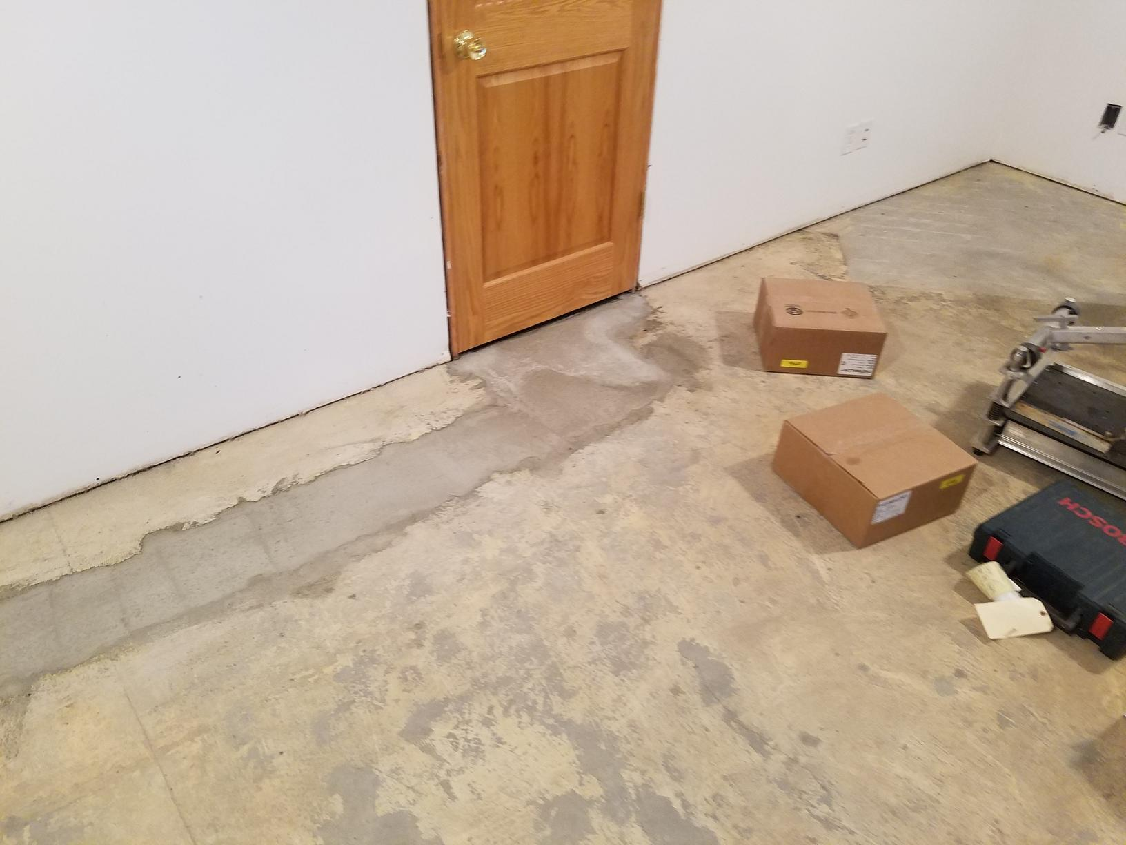 Before the tile is installed.