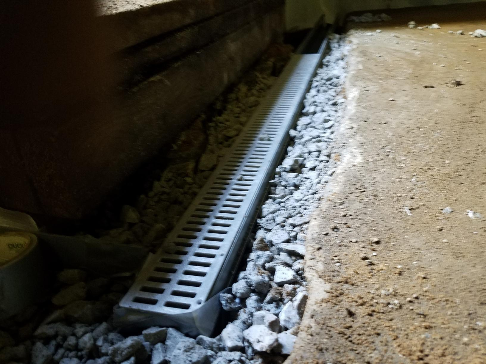 The trench drain helps channel water out.