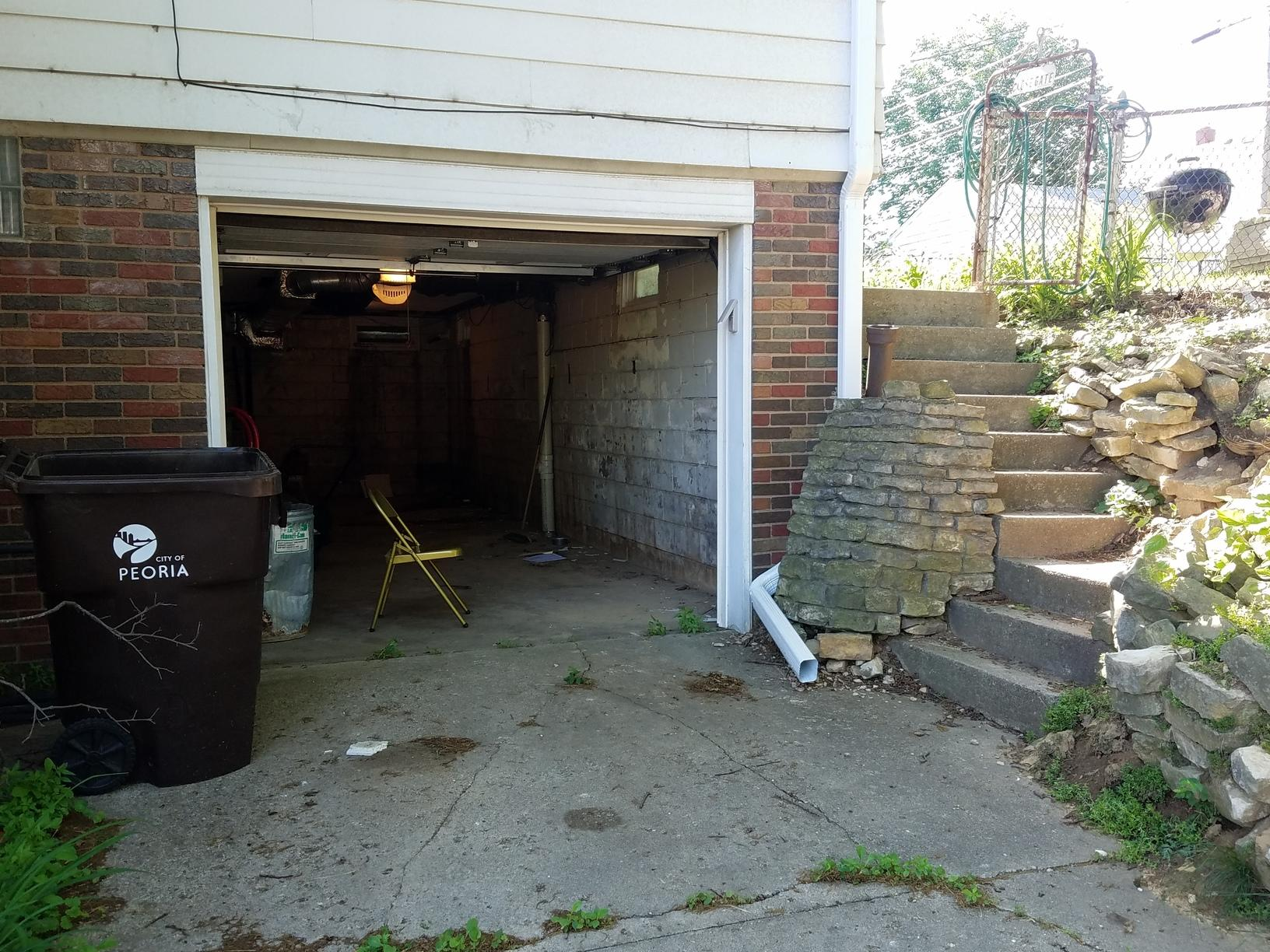 The garage wall was bowing and cracking.