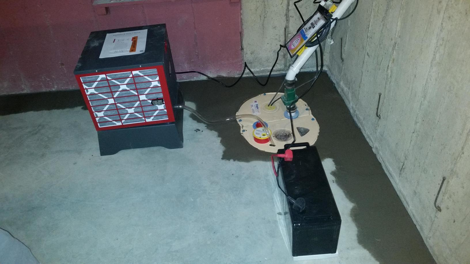 Pictured is the new sump pump with the battery back up along with a SaniDry dehumidifier.