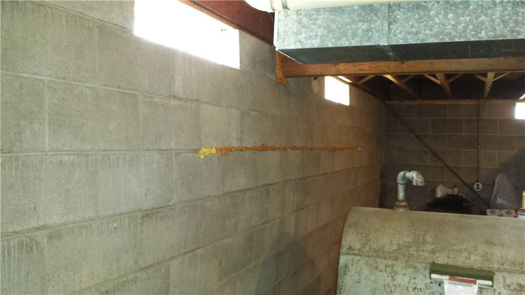 The bowing wall before the foundation system was installed.