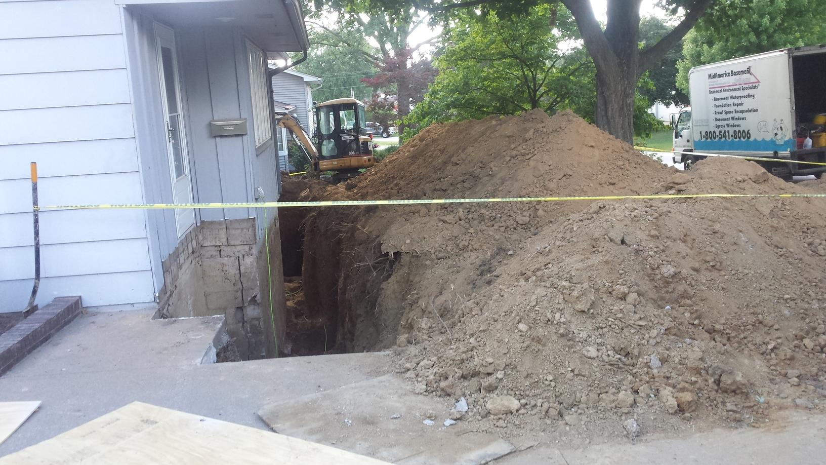The earth around the home is removed and then the work can be started.