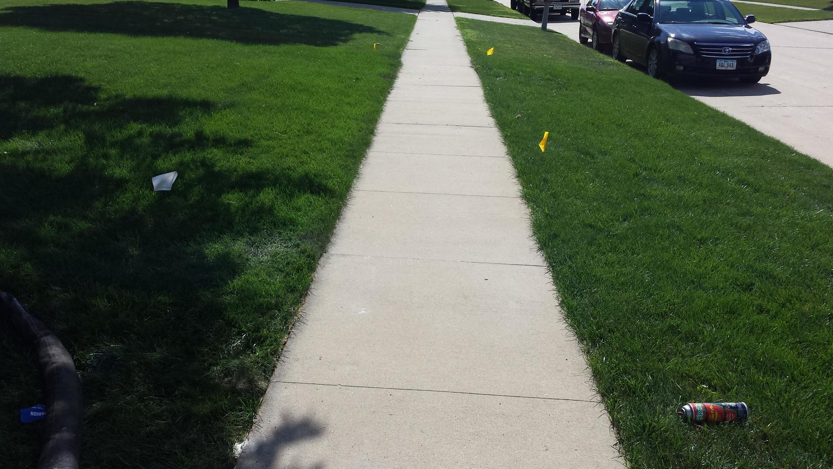The new sidewalk after it has been lifted and leveled.
