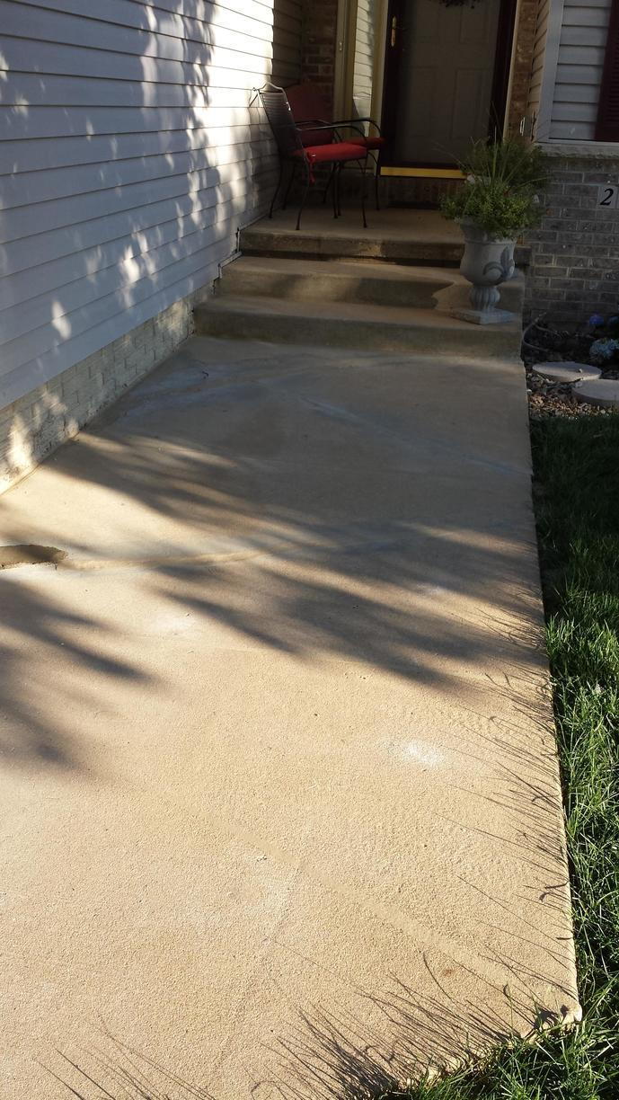 The sidewalk after it has been repaired with the polyfoam.