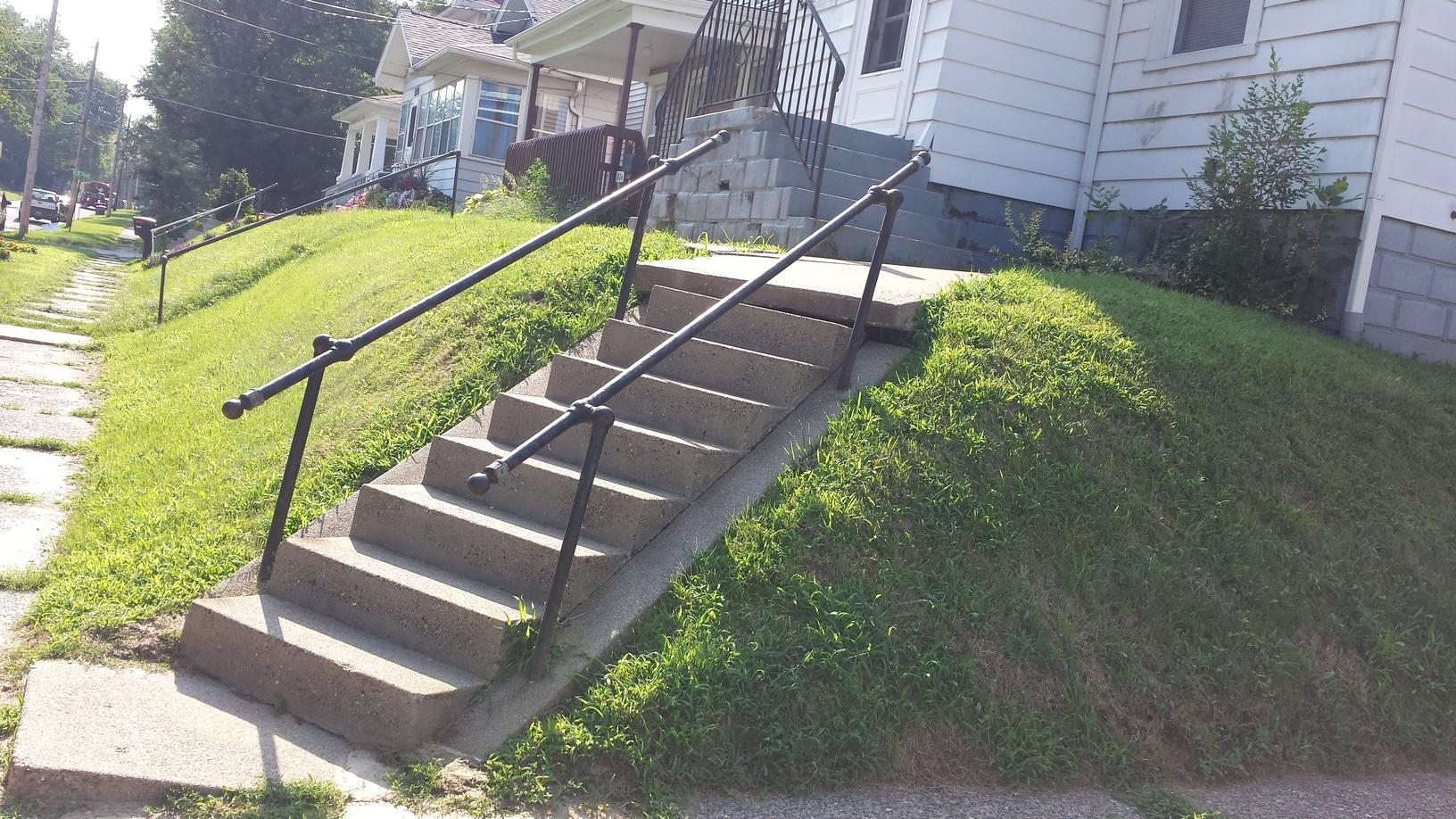 The concrete steps are sinking and uneven. They are a trip hazard and dangerous.