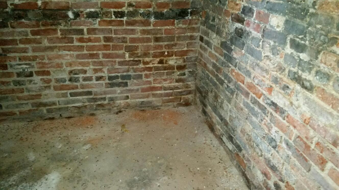 The walls before the basement waterproofing.
