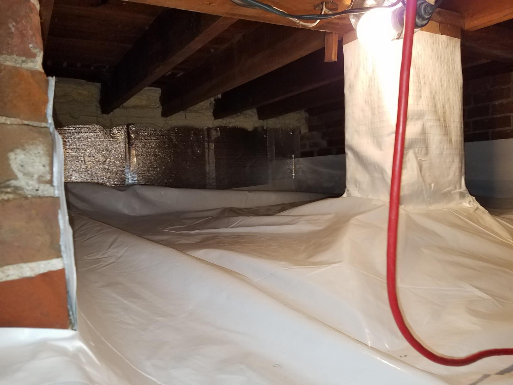 The foundation pillars are also covered to make sure the crawlspace is fully sealed.