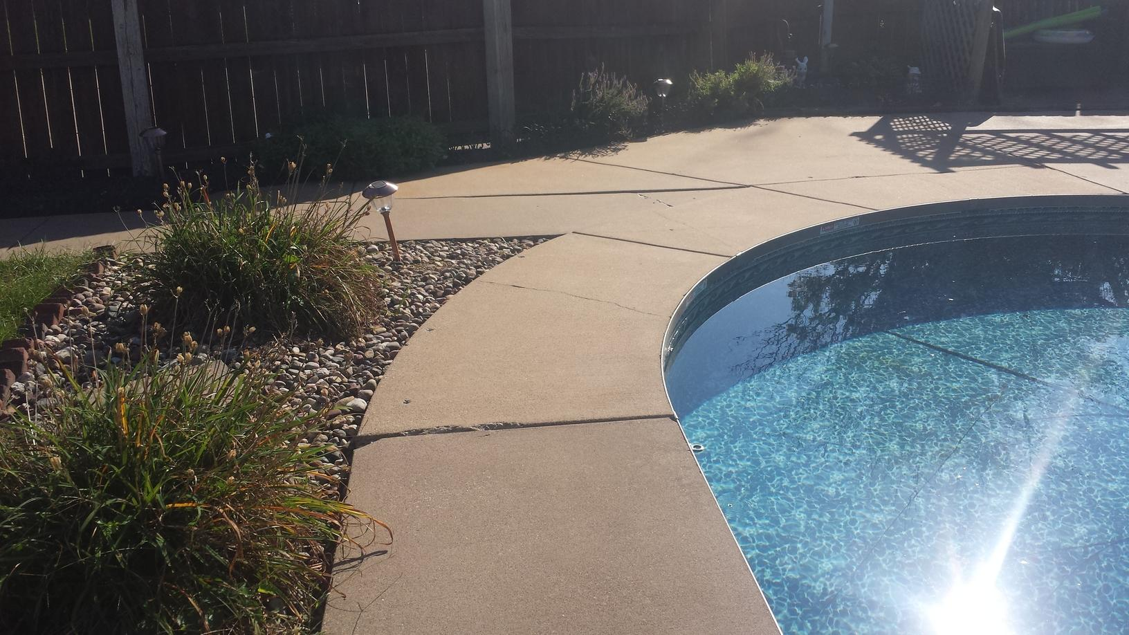 The cracking pool deck before repair.