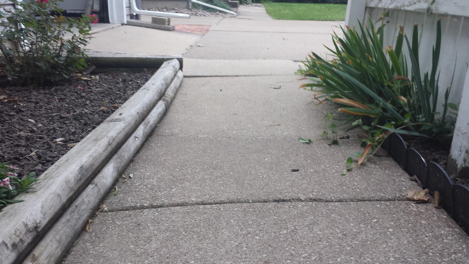 The cracking and sealing of the sidewalk was causing the joints to expand in between each slab.